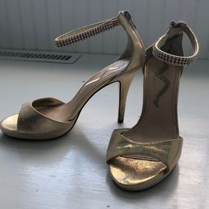 Gold heels with silver rhinestone ankle straps